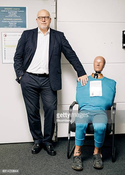 Dirk Babock general manager of global technical area testing at Magna International Inc stands for a photograph next to a crash test dummy at the...