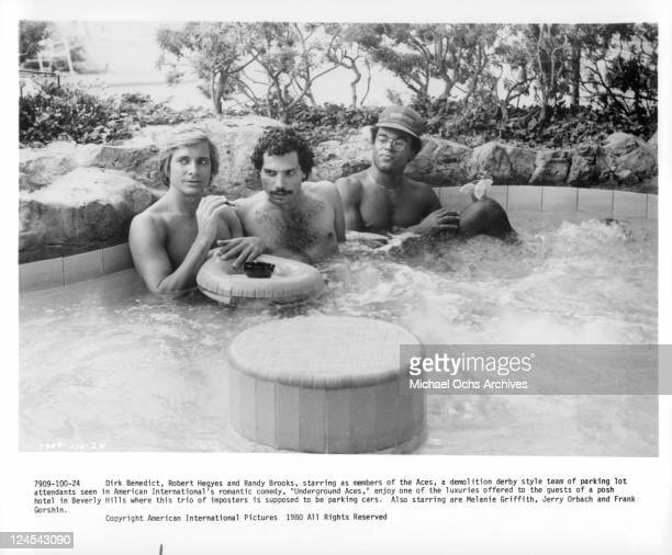 Dirk Benedict Robert Hegyes and Randy Brooks in a whirlpool in a scene from the film 'Underground Aces' 1980