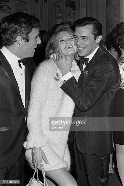Dirk Bogarde Angie Dickinson and Burt Bacharach at a formal event circa 1970 New York