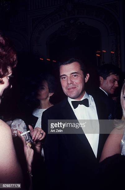 Dirk Bogarde in a tux at a formal event circa 1960 New York