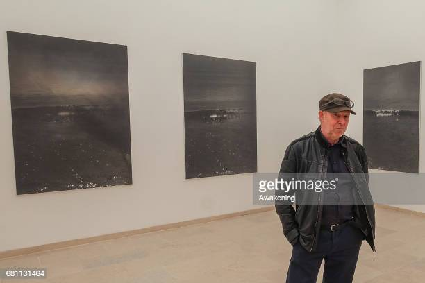 Dirk Braeckman poses at the Belgian pavilion presenting Dirk Braeckman of Dirk Braeckman at Giardini during the 57th Internaztional Art Exhibition of...