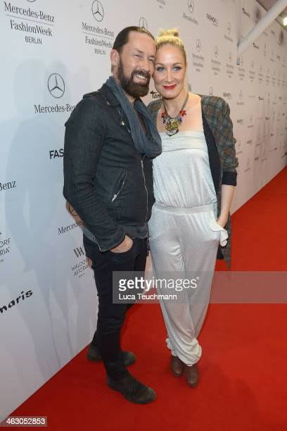 Dirk Budach and Janine Kunze arrive for the Guido Maria Kretschmer Show during MercedesBenz Fashion Week Autumn/Winter 2014/15 at Brandenburg Gate on...
