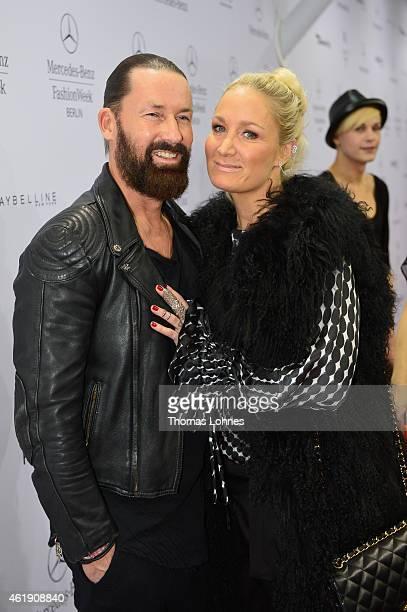 Dirk Budach and Janine Kunze attend the Guido Maria Kretschmer show during the MercedesBenz Fashion Week Berlin Autumn/Winter 2015/16 at Brandenburg...