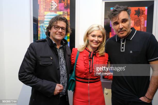 Dirk Geuer Petra Dieners and David LaChappelle attend the 'LACHAPELLE Negative Currency' Exhibition Opening at Geuer und Geuer on April 24 2018 in...