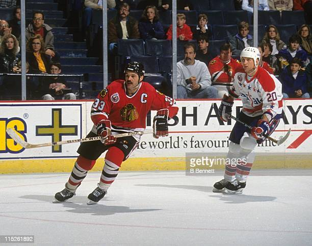 Dirk Graham of the Chicago Blackhawks skates on the ice as Michal Pivonka of the Washington Capitals follows behind during their game on January 2,...