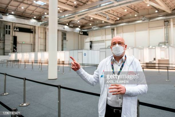 Dirk Heinrich, a senior physician of the new vaccination center in Hamburg, gestures as he presents facilities on December 18, 2020 at a corona...