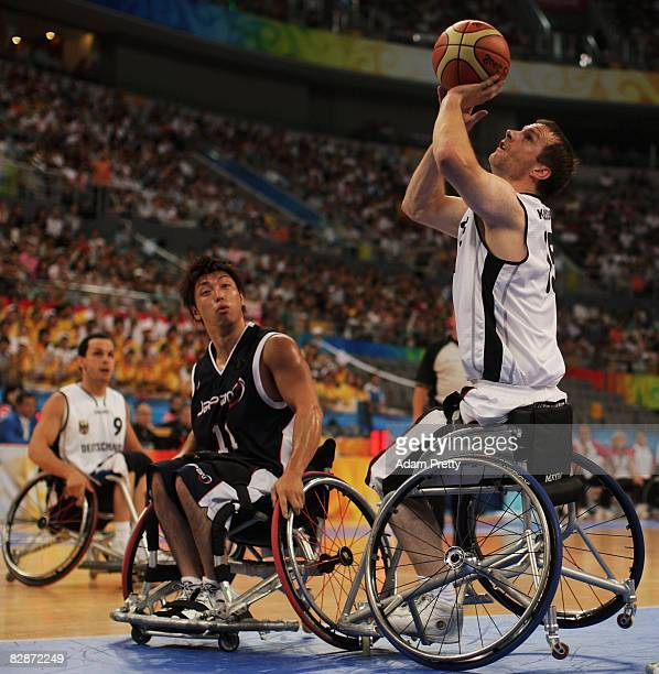 Dirk KohlerLenz of Germany shoots in the Wheelchair Basketball match between Germany and Japan at the National Indoor Stadium during day nine of the...