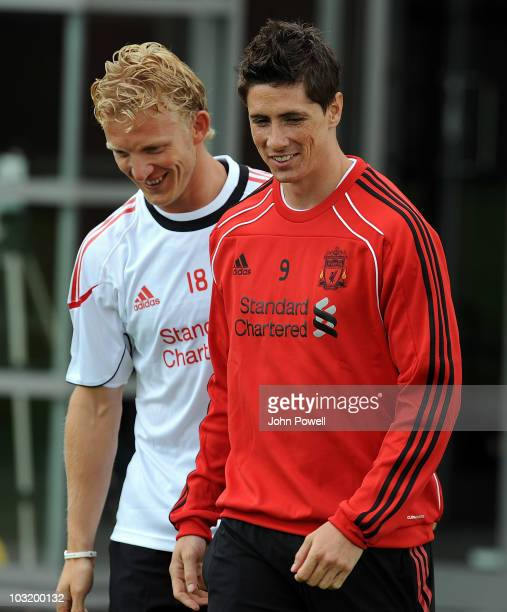 Dirk Kuyt and Fernando Torres of Liverpool share a joke during their first training session since returning from the World Cup at Melwood training...