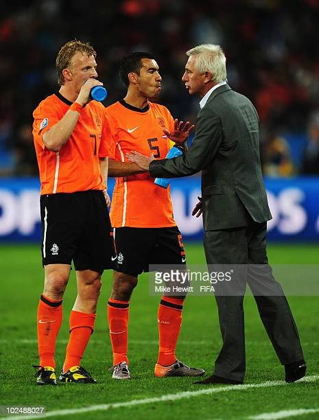 Dirk Kuyt and Giovanni Van Bronckhorst of the Netherlands receive instructions from head coach Bert van Marwijk during the 2010 FIFA World Cup South...