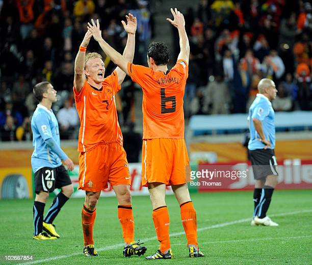 Dirk Kuyt and Mark van Bommel of the Netherlands celebrate victory and progressing to the final after the 2010 FIFA World Cup South Africa Semi Final...