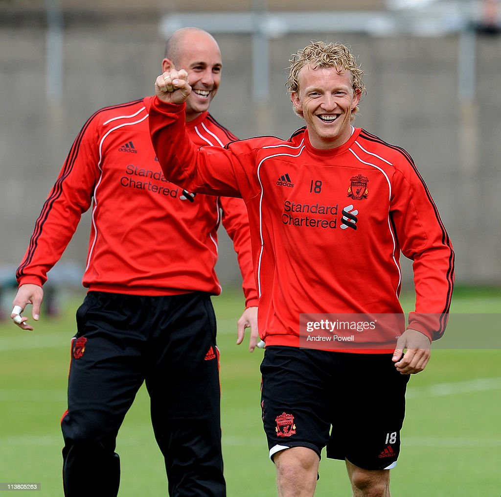 Dirk Kuyt (R) and Pepe Reina of Liverpool smile during a Liverpool training session at Melwood Training Ground on May 6, 2011 in Liverpool, England.