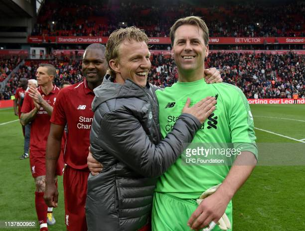 Dirk Kuyt and Sander Westerveld of Liverpool FC Legends showing his appreciation to the fans at the end of the friendly match between Liverpool FC...