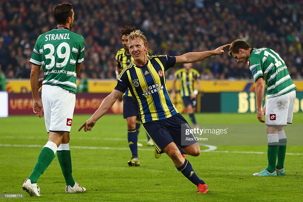 Dirk Kuyt of Fenerbahce celebrates his team's third goal during the UEFA Europa League group C match between Borussia Moenchengladbach and Fenerbahce SK at Borussia-Park on October 4, 2012 in Moenchengladbach, Germany.