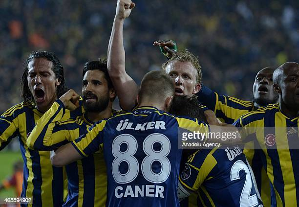 Dirk Kuyt of Fenerbahce celebrates his team's victory with his friends after the Turkish Spor Toto Super League derby game between Fenerbahce and...