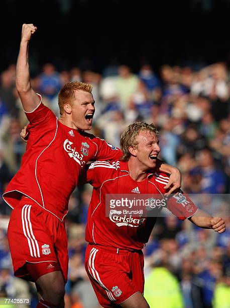 Dirk Kuyt of Liverpool celebrates at the final whistle with John Arne Riise during the Barclays Premier League match between Everton and Liverpool at...