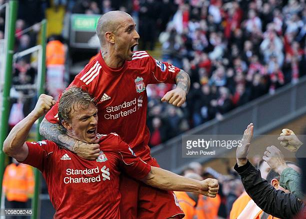 Dirk Kuyt of Liverpool celebrates his third goal with Raul Meireles during the Barclays Premier League match between Liverpool and Manchester United...