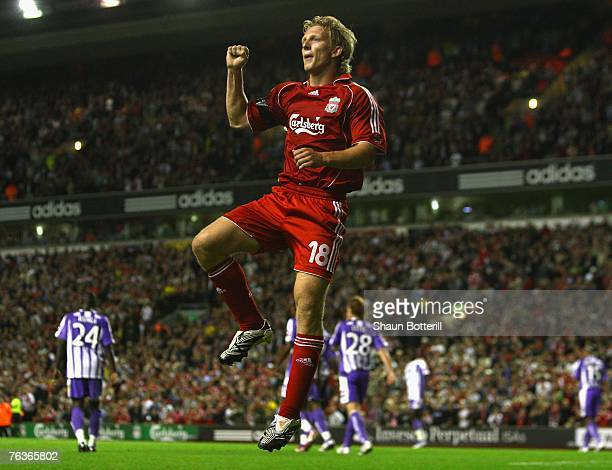 Dirk Kuyt of Liverpool celebrates scoring his team's third goal during the UEFA Champions League Qualifier third round second leg match between...