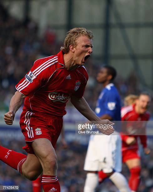 Dirk Kuyt of Liverpool celebrates scoring the first goal from the penalty spot during the Barclays Premier League match between Everton and Liverpool...