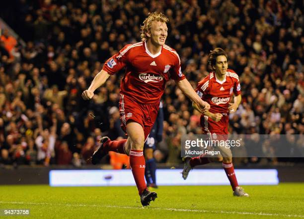 Dirk Kuyt of Liverpool celebrates scoring the opening goal during the Barclays Premier League match between Liverpool and Arsenal at Anfield on...