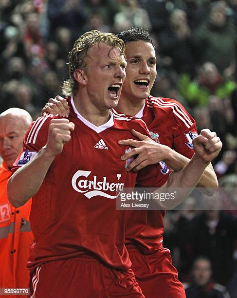 Dirk Kuyt of Liverpool celebrates scoring the opening goal with team mate Philipp Degen during the Barclays Premier League match between Liverpool...