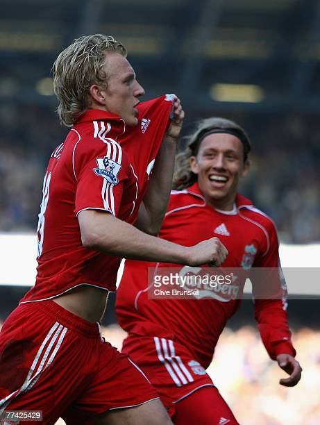 Dirk Kuyt of Liverpool celebrates scoring the winning goal from the penalty spot with Lucas during the Barclays Premier League match between Everton...