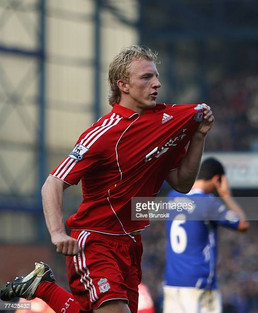 Dirk Kuyt of Liverpool celebrates scoring the winning goal from the penalty spot during the Barclays Premier League match between Everton and...