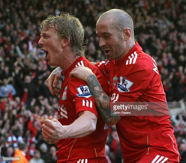 Dirk Kuyt of Liverpool celebrates scoring their third goal with Raul Meireles during the Barclays Premier League match between Liverpool and...