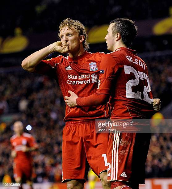 Dirk Kuyt of Liverpool celebrates with Danny Wilson after scoring the winning goal during the UEFA Europa League match round of 32 second leg between...