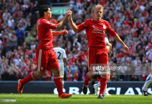 Dirk Kuyt of Liverpool celebrates with team mate Luis Suarez after scoring the second goal from the penalty spot during the Barclays Premier League...