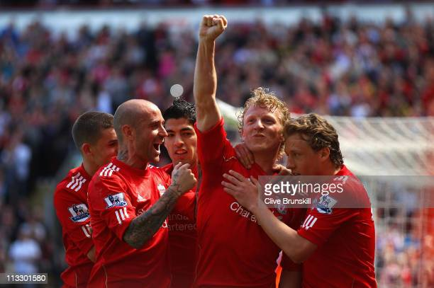 Dirk Kuyt of Liverpool celebrates with team mates after scoring the second goal from the penalty spot during the Barclays Premier League match...
