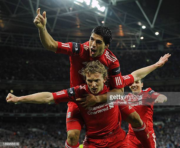Dirk Kuyt of Liverpool celebrates with teammate Luis Suarez after scoring a goal during the Carling Cup Final match between Liverpool and Cardiff...