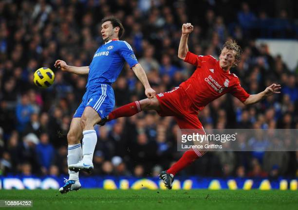 Dirk Kuyt of Liverpool challenges Branislav Ivanovic of Chelsea during the Barclays Premier League match between Chelsea and Liverpool at Stamford...