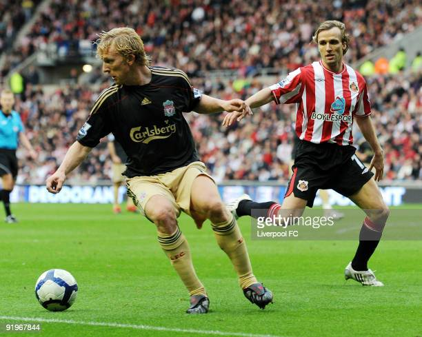 Dirk Kuyt of Liverpool competes with Bolo Zenden of Sunderland during the Barclays Premier League match between Sunderland and Liverpool at the...