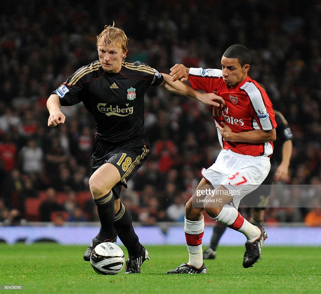 Dirk Kuyt of Liverpool competes with Craig Eastmond of Arsenal during the match between LiverpooL FC and Arsenal during the Carling Cup Fourth round at Emirates Stadium on October 28, 2009 in London, England.