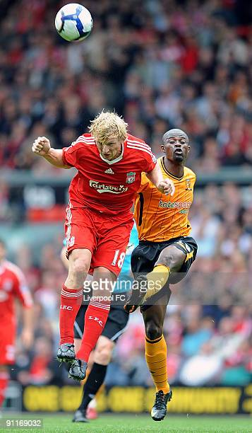 Dirk Kuyt of Liverpool competes with George Boateng captain of Hull City during the Barclays Premier League match between Liverpool and Hull City at...
