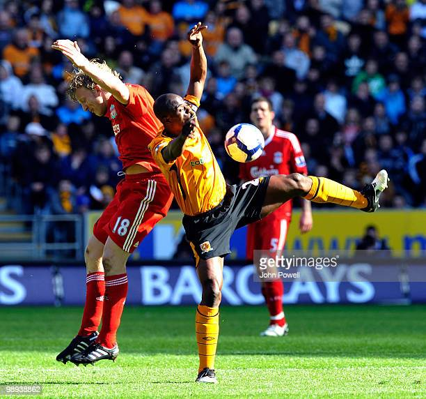 Dirk Kuyt of Liverpool competes with George Boateng of Hull City during the Barclays Premier League match between Hull City and Liverpool at KC...