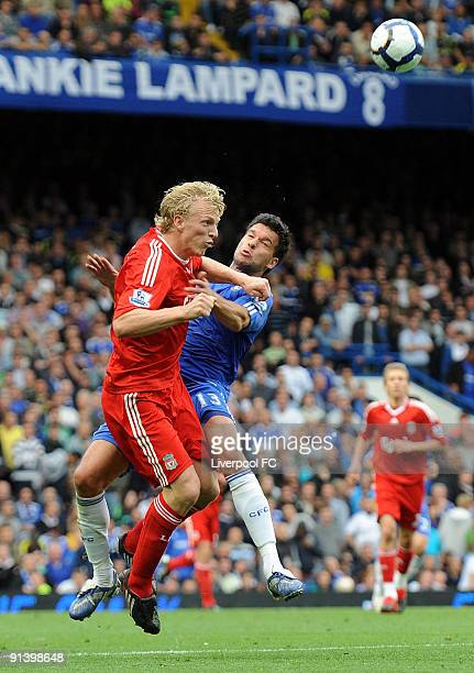 Dirk Kuyt of Liverpool competes with Michael Ballack of Chelsea during the Barclays Premier League match between Chelsea and Liverpool at Stamford...