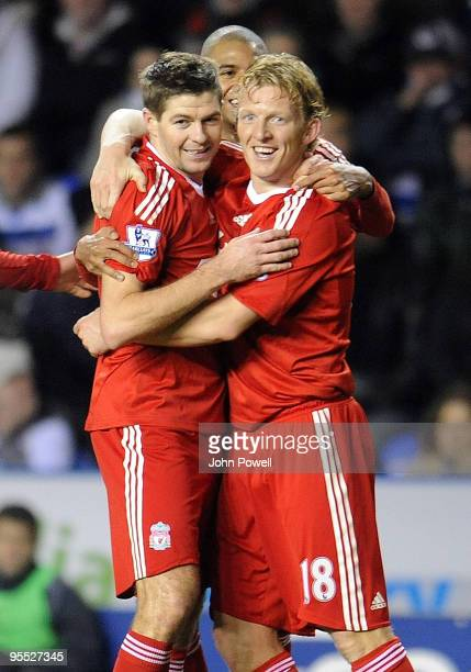 Dirk Kuyt of Liverpool congratulates goal scorer Steven Gerrard after he scored the equalizing goal during the FA Cup 3rd round match between Reading...
