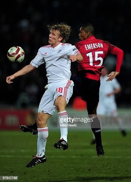 Dirk Kuyt of Liverpool is challenged by Emerson of Lille during the UEFA Europa League last 16 1st leg match between Lille and Liverpool on March 11...