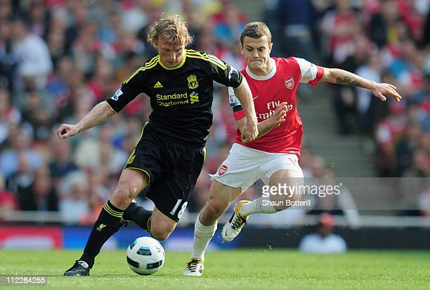 Dirk Kuyt of Liverpool is closed down by Jack Wilshere of Arsenal during the Barclays Premier League match between Arsenal and Liverpool at the...