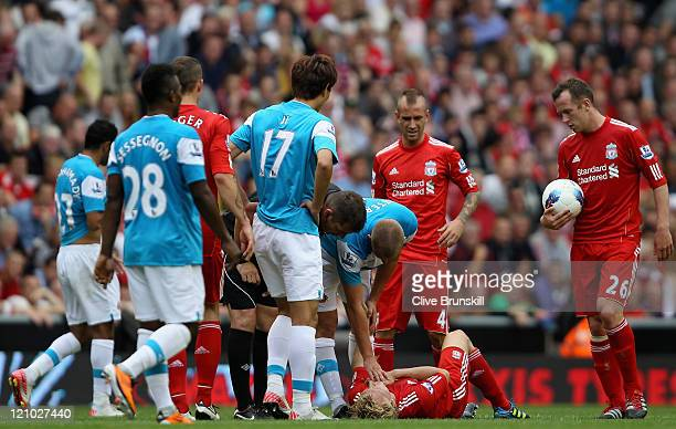 Dirk Kuyt of Liverpool lies injured during the Barclays Premier League match between Liverpool and Sunderland at Anfield on August 13 2011 in...