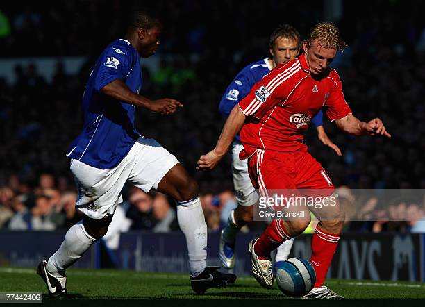 Dirk Kuyt of Liverpool moves away from Joseph Yobo and Phil Neville of Everton during the Barclays Premier League match between Everton and Liverpool...