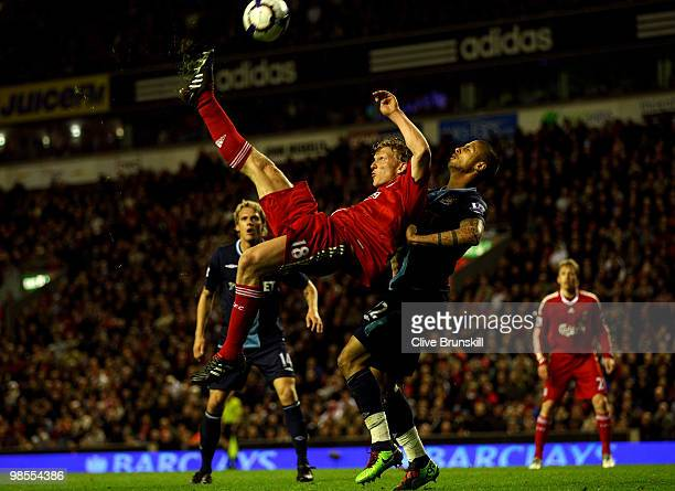 Dirk Kuyt of Liverpool performs a bicycle kick under pressure from Manuel Da Costa of West Ham United during the Barclays Premier League match...