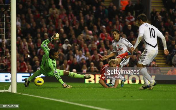 Dirk Kuyt of Liverpool scores but his goal is later disallowed during the Barclays Premier League match between Liverpool and Swansea City at Anfield...