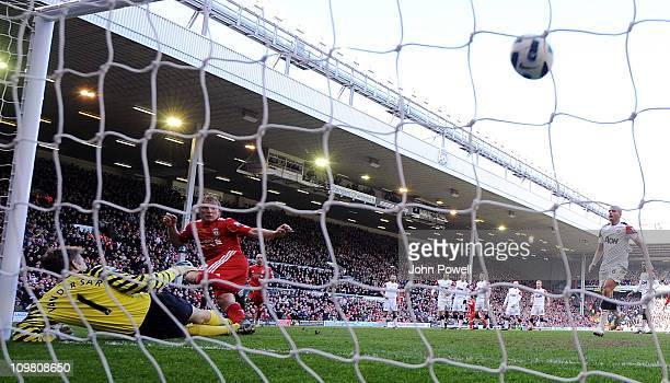 Dirk Kuyt of Liverpool scores his hat-trick goal during the Barclays Premier League match between Liverpool and Manchester United at Anfield on March...