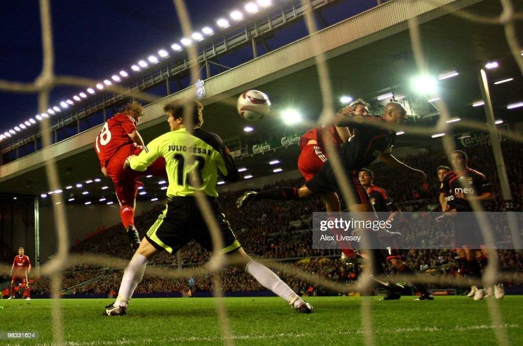 Dirk Kuyt of Liverpool scores the opening goal past Julio Cesar of Benfica during the UEFA Europa League Quarter Final second leg match between Liverpool and Benfica at Anfield on April 8, 2010 in Liverpool, England.