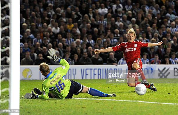 Dirk Kuyt of Liverpool scores the second during the Carling Cup third round match between Brighton & Hove Albion and Liverpool at Amex Stadium on...