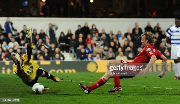 Dirk Kuyt of Liverpool scores the second goal during the Barclays Premier League match between Queens Park Rangers and Liverpool at Loftus Road on...
