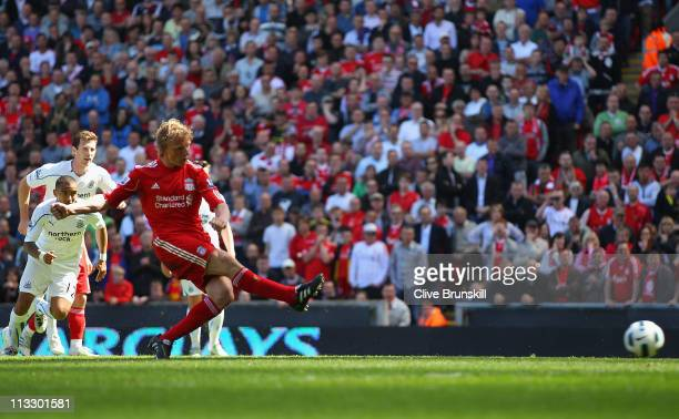 Dirk Kuyt of Liverpool scores the second goal from the penalty spot during the Barclays Premier League match between Liverpool and Newcastle United...