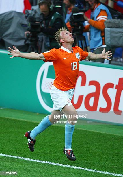 Dirk Kuyt of Netherlands celebrates after scoring the opening goal during the UEFA EURO 2008 Group C match between Netherlands and France at Stade de...